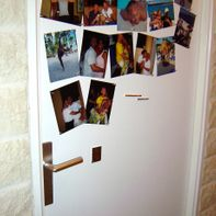 Photo door with magnetic paint